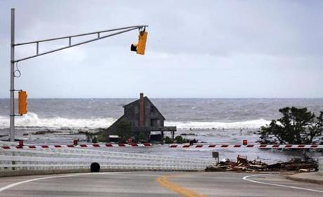 A lone home stood on the beach in an area that residents say was filled with homes before the hurricane in Mantoloking, N.J.